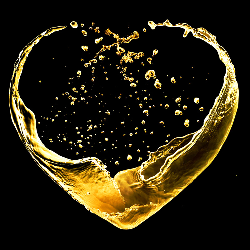 Valentine day heart made of gold splash isolated on black